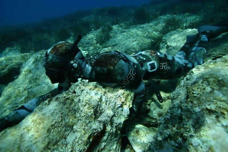 Camo coud be important, but the spearfishing is hiding himself using the bottom.